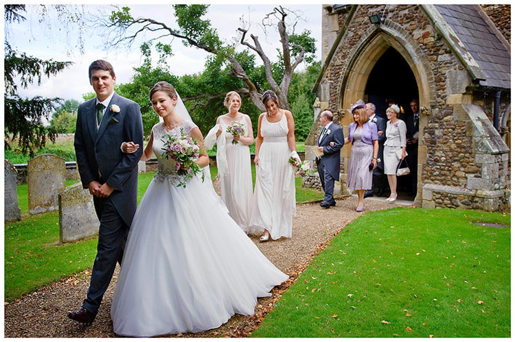 Hemingford Grey wedding bridal party coming out of church