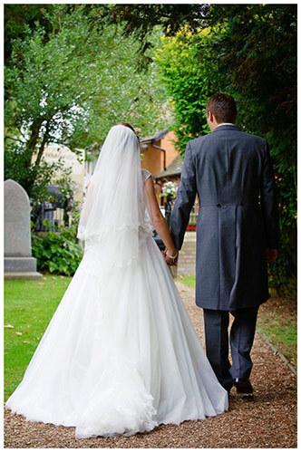 Hemingford Grey wedding bride groom walking along path