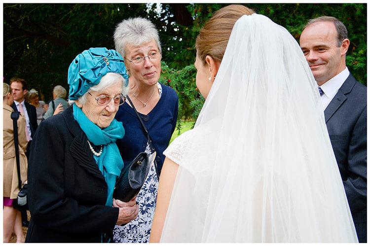 Hemingford Grey wedding bride talking to guests