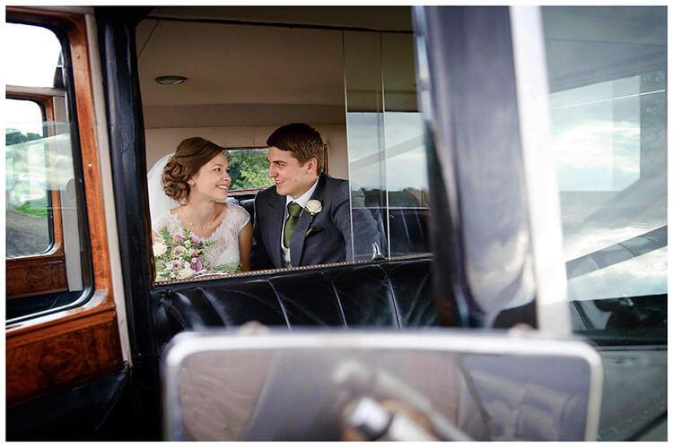 belfry hotel wedding bride groom sat in wedding car
