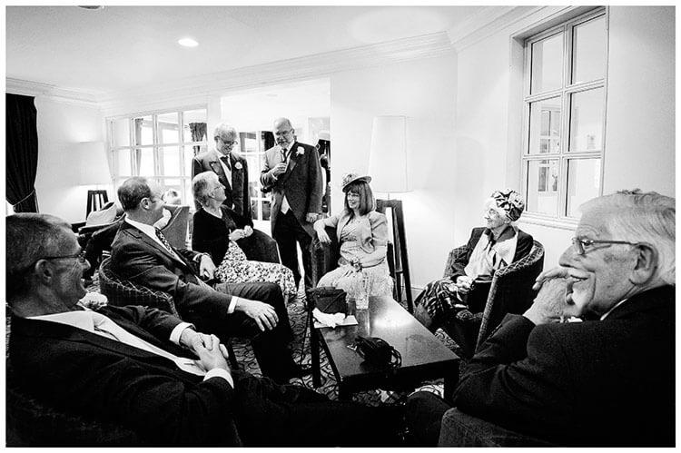 belfry hotel wedding guests sat down talking