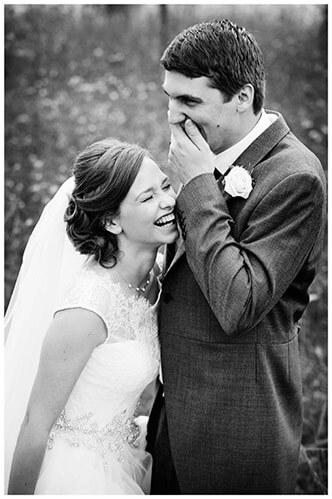 belfry hotel wedding groom bride laughing