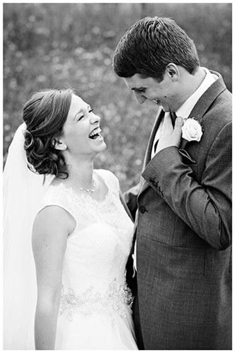 belfry hotel wedding bride groom laughing