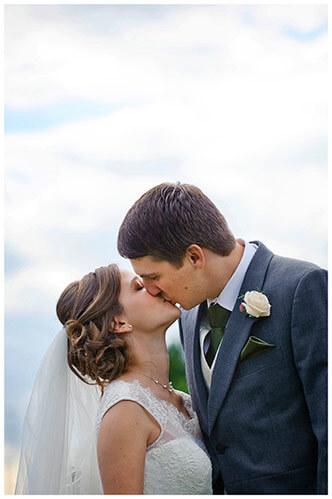 belfry hotel wedding bride groom kiss