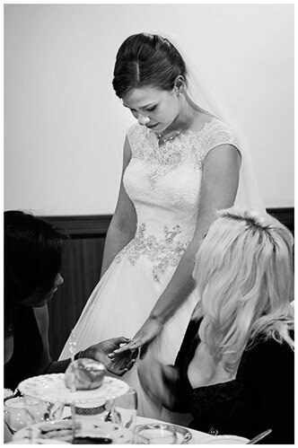 belfry hotel wedding bride showing wedding band to female guets