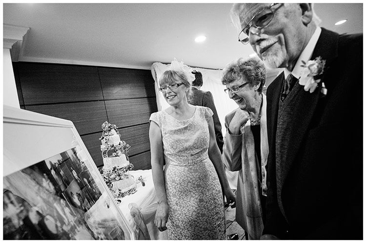 belfry hotel wedding guests looking at photo board