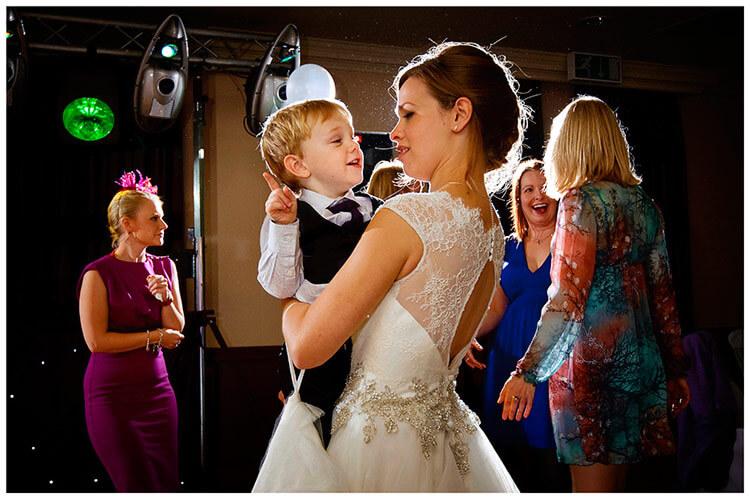 belfry hotel wedding bride and little guest dancing