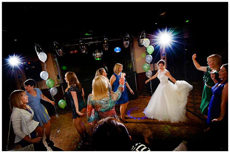 belfry hotel wedding bride female guests on dance floor