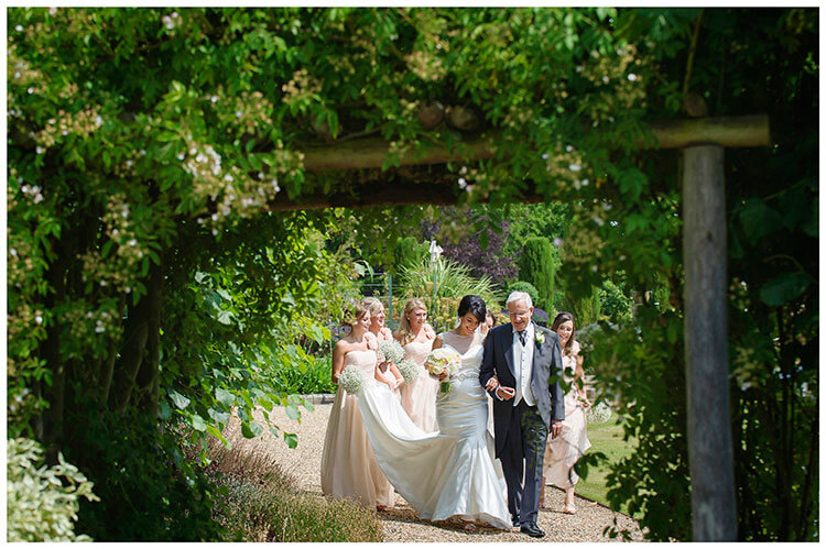 chippenham park summer wedding bridal party walking to ceremony