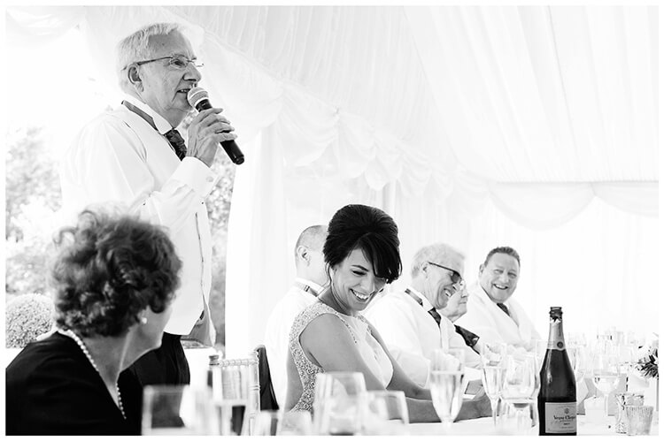 chippenham park summer wedding smiling bride during fathers speech