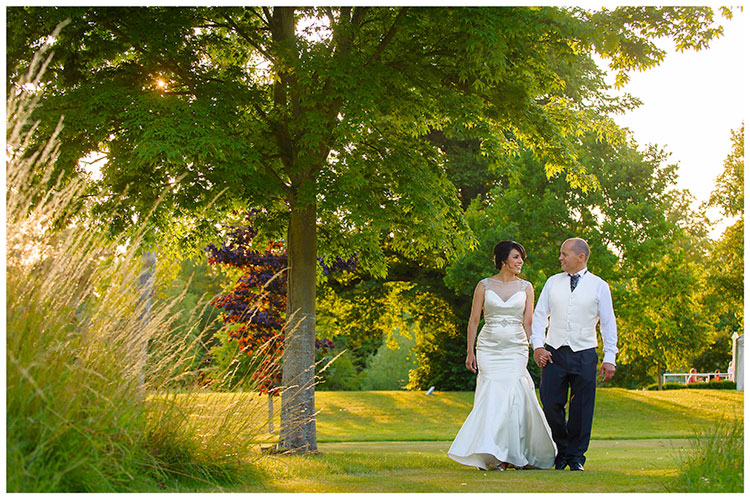 chippenham park summer wedding bride groom go for a walk in gardens