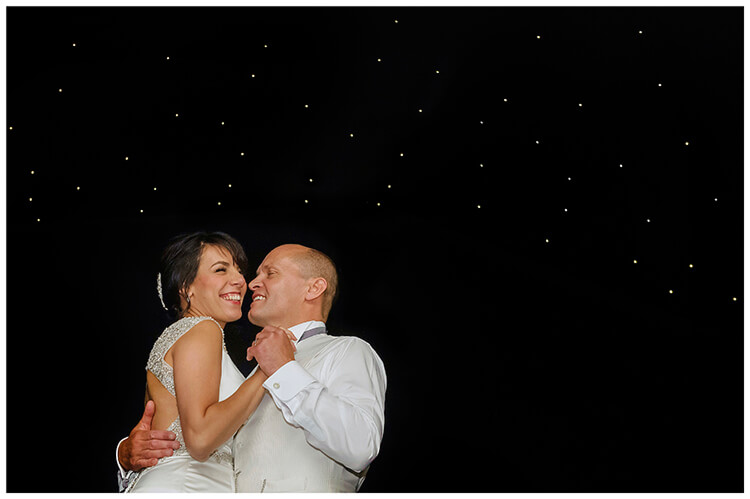 chippenham park summer wedding smiling bride groom first dance under starlight canopy