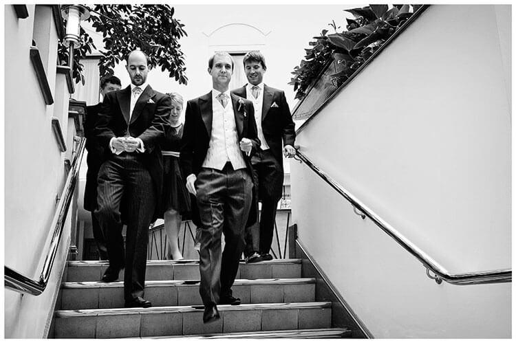 Emmanuel College wedding grooms men walking down steps
