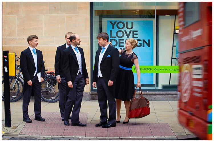 Emmanuel College wedding whilst waiting cross road adjust collar