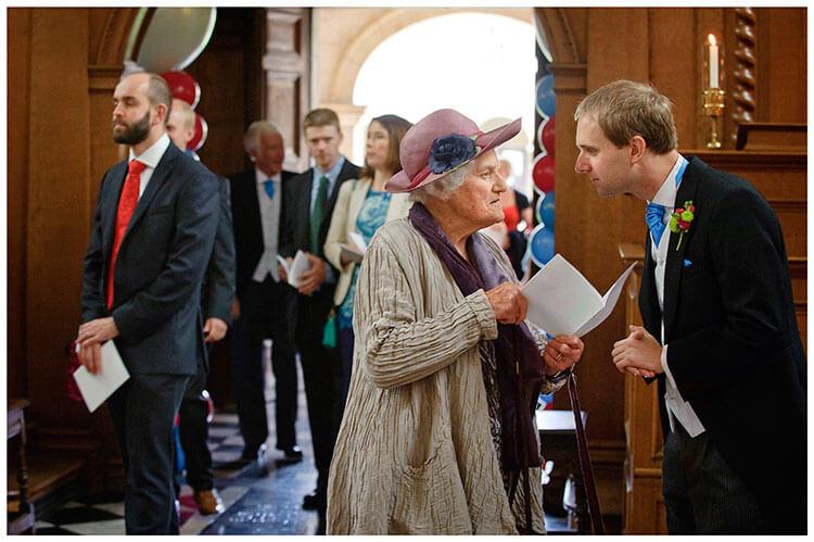 Emmanuel College wedding groom talking to grandmother