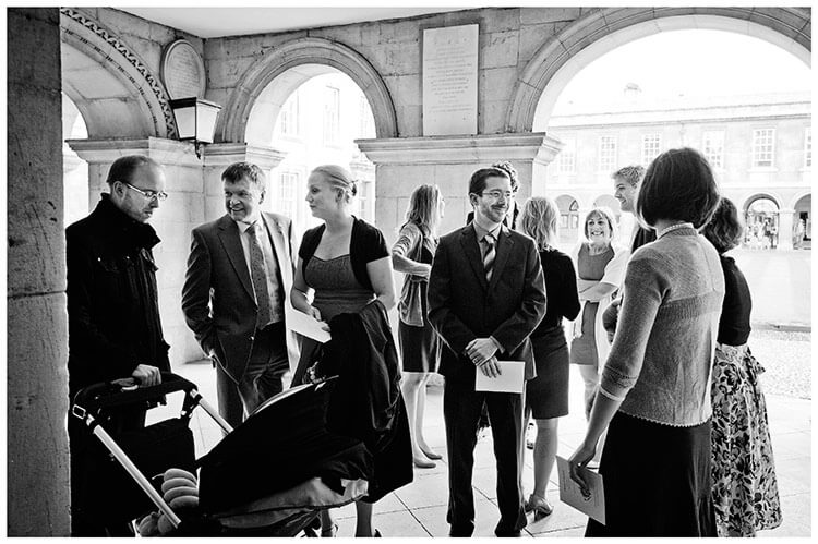 Emmanuel College wedding guests waiting to go in to chapel