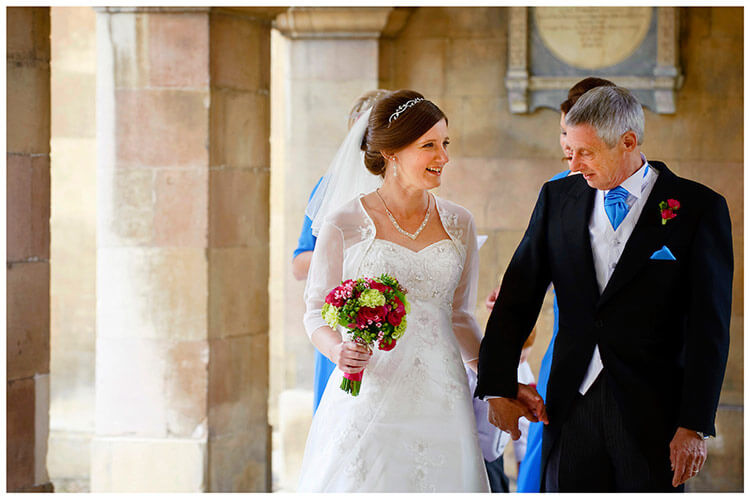 Emmanuel College wedding bride smiling at father before going into chapel