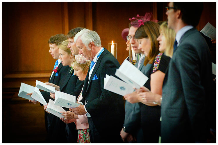 Emmanuel College wedding guests sing a hymn