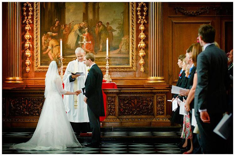 Emmanuel College wedding bride groom hold hands at alter