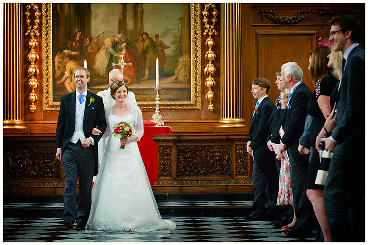 Emmanuel College wedding bride groom start to walk down aisle watched by guests