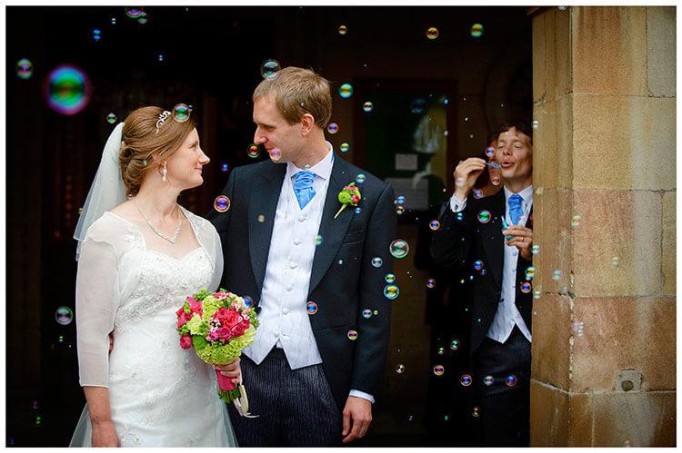 Emmanuel College wedding bride groom bubbles confetti