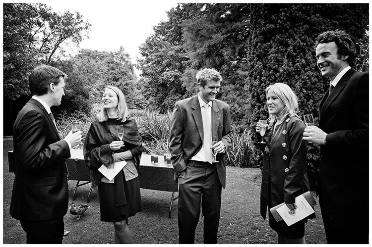 Emmanuel College wedding guests enjoying a drink in gardens