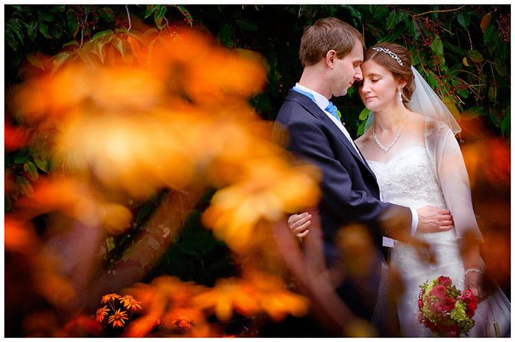 Emmanuel College wedding bride groom embrace in gardens