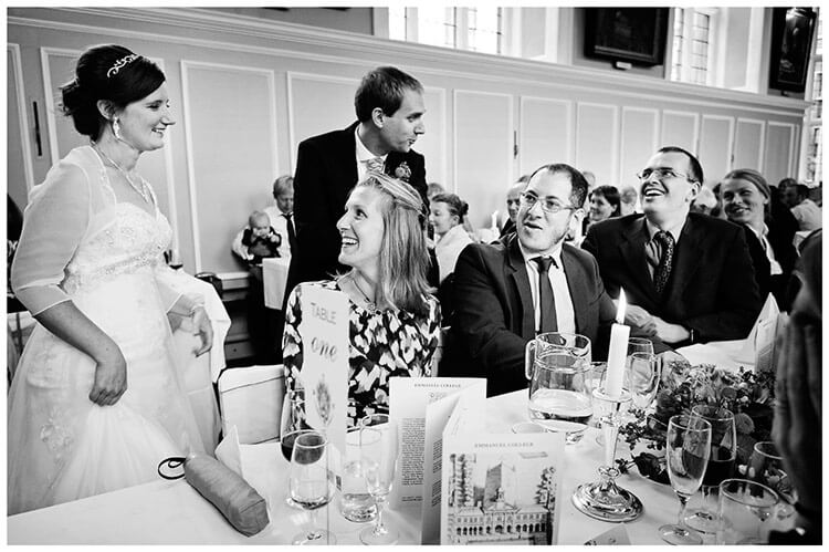 Emmanuel College wedding bride groom talking to sitting guests