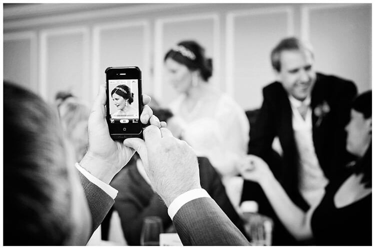 Emmanuel College wedding brides portrait on phone