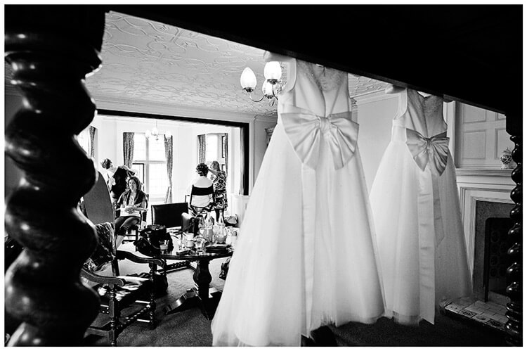 Fanhams Hall wedding flower girl dresses hanging on bed frame