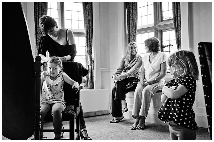 Fanhams Hall wedding unhappy flowergirl getting hair done watched by another flowergirl
