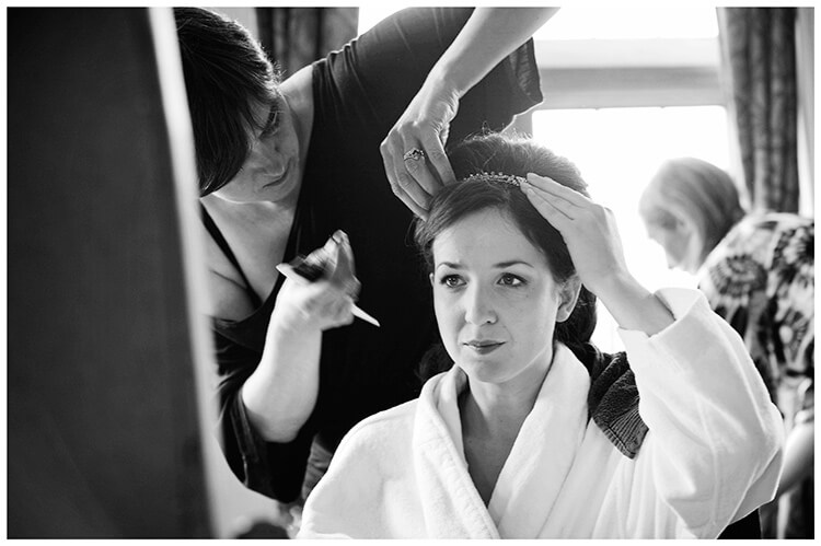 Fanhams Hall wedding bride getting hair done