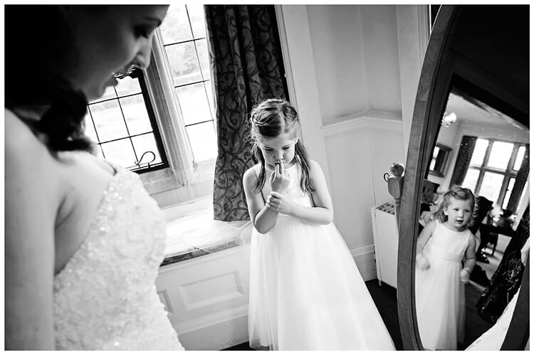 Fanhams Hall wedding flower girl watching bride getting ready