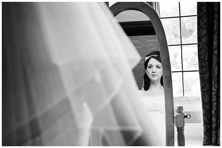 Fanhams Hall wedding bride reflected in mirror