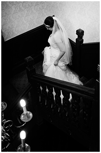 Fanhams Hall wedding bride walking down stairs