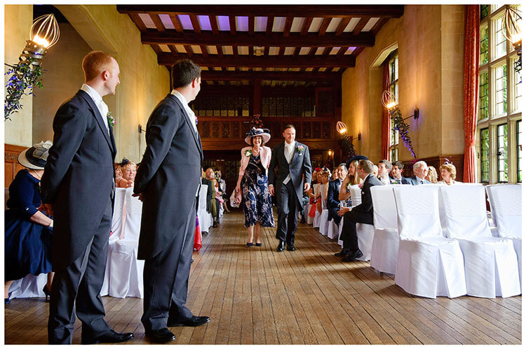 Fanhams Hall wedding groom watches guests arrive