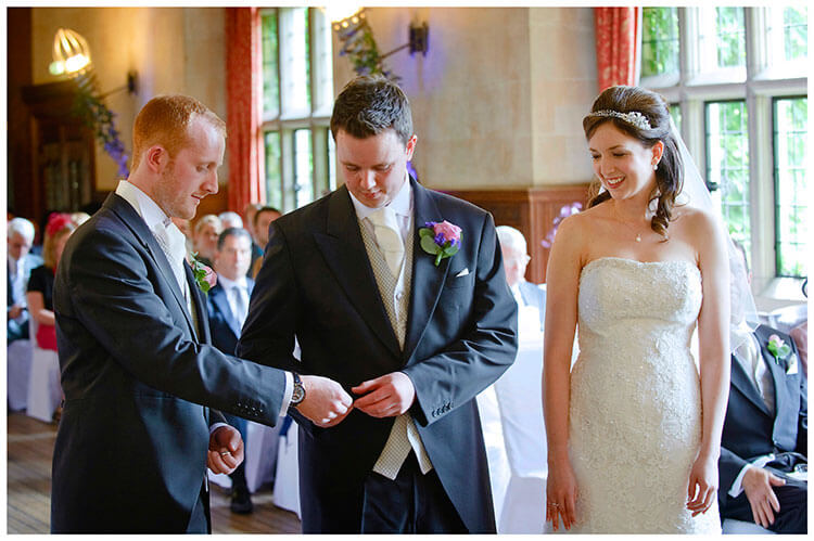Fanhams Hall wedding bestman passes wedding band to groom