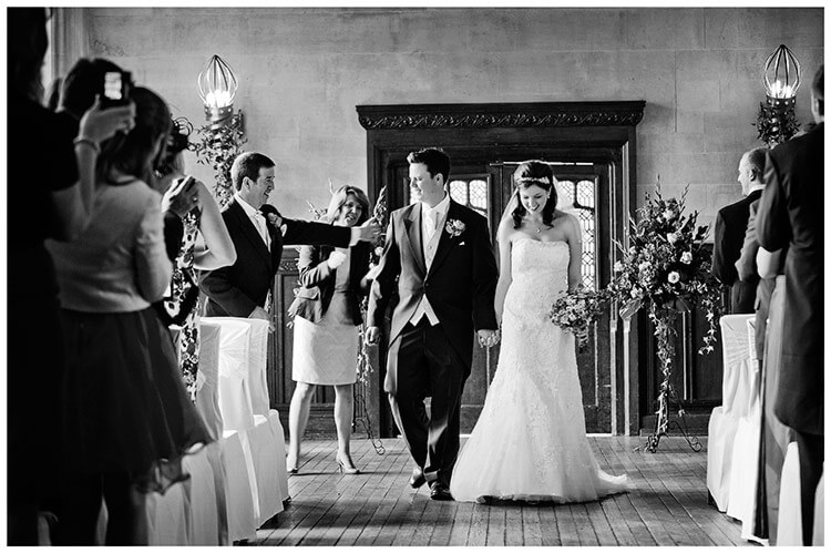 Fanhams Hall wedding congratulations as bride groom leave after ceremony
