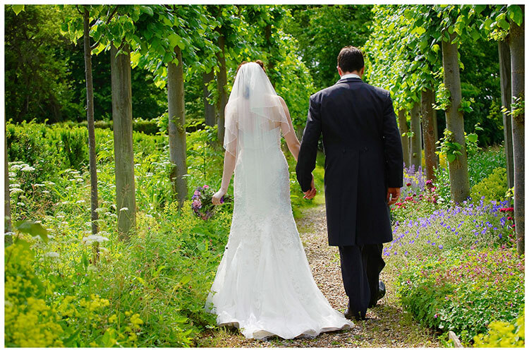 Fanhams Hall wedding bride groom romantic walk through flower garden
