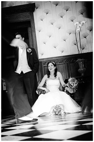Fanhams Hall wedding bride sitting in chair checkered floor