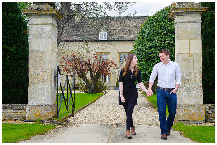 Friars Court Oxfordshire Pre-Wedding Photoshoot  romantic couple hold hands walking
