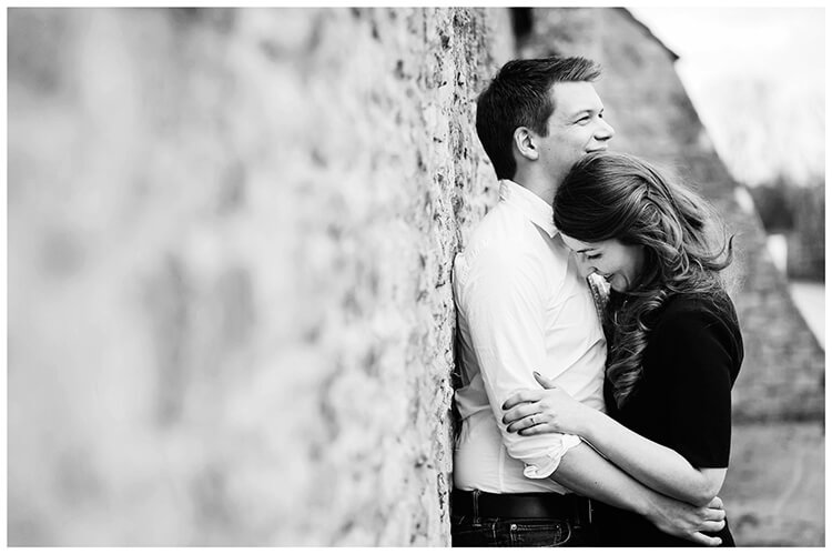 Friars Court Oxfordshire Pre-Wedding Photoshoot  romantic embrace leaning against wall