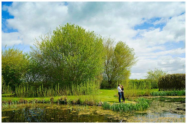 Friars Court Oxfordshire Pre-Wedding Photoshoot  romantic embrace near lake