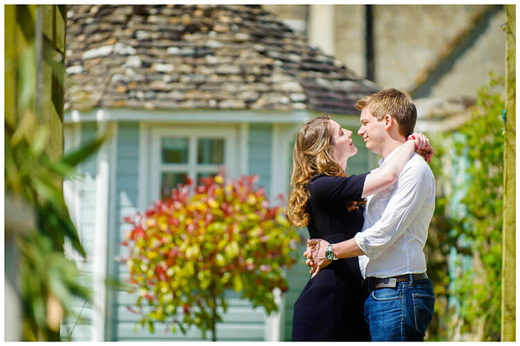 Friars Court Oxfordshire Pre-Wedding Photoshoot  romantic couple embrace in sunlight