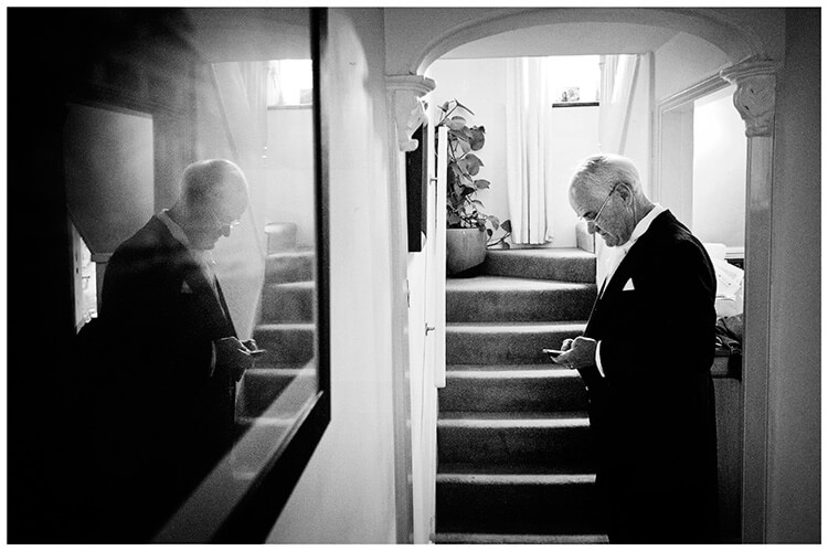 Longstowe Hall Wedding father bride check phone