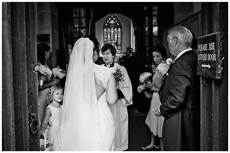 Longstowe Hall Wedding bridal party in the entrance of church
