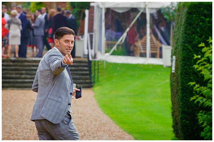 Longstowe Hall Wedding pointing guest