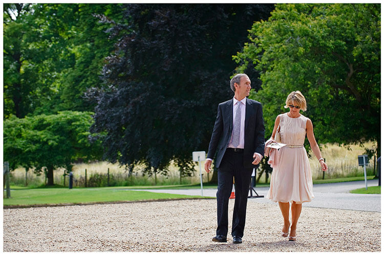 Madingley Hall Wedding couple of guests arrive
