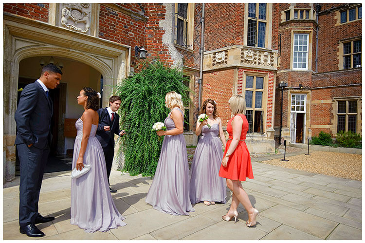 Madingley Hall Wedding bridesmaids waiting outside enterance