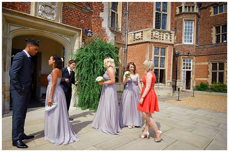 Madingley Hall Wedding bridesmaids waiting outside enterance